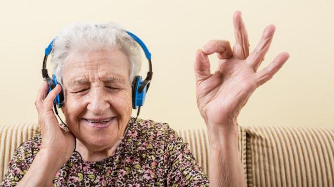 older-lady-listening-to-music-on-headphones