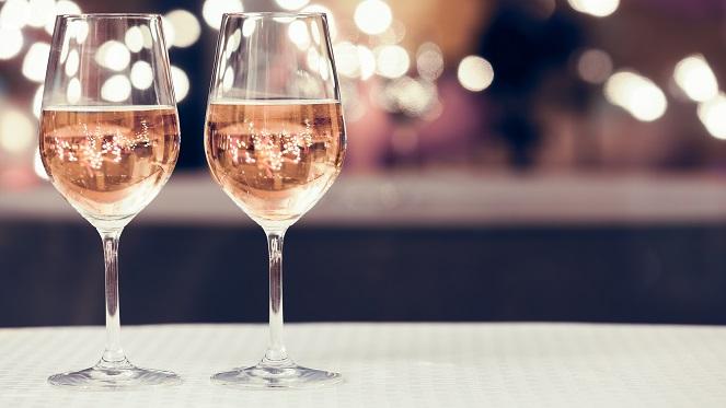 Wine glasses in a restaurant setting.