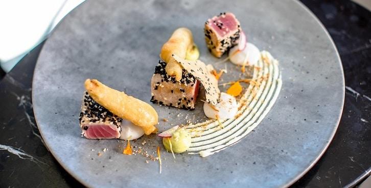 Seared 'Yellow Fin' tuna with coconut puree, avocado, wasabi labneh and anchovies